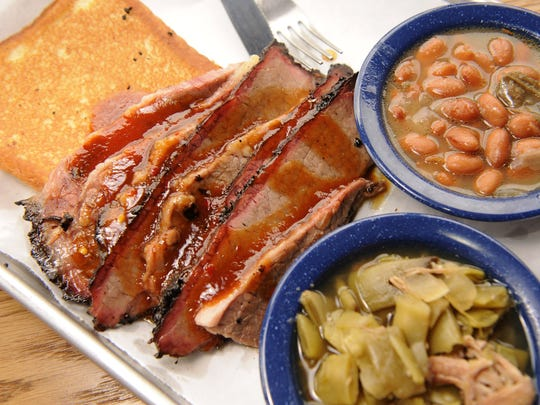 Martin's Bar-B-Que's brisket plate with Southern belle sauce, Texas toast, pintos and green beans.