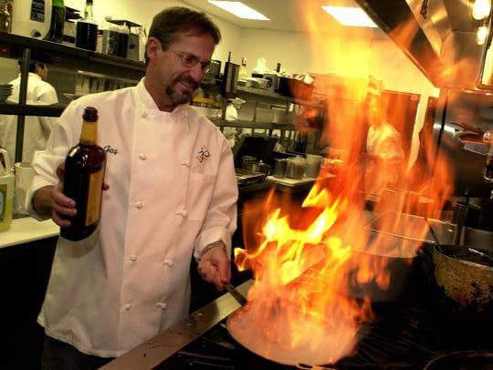 Former Jay's Bistro owner Jay Witlen cooks up a meal.