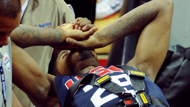 Team USA guard Paul George is carted off the floor on a gurney after suffering a lower leg injury during the USA Basketball Showcase at Thomas & Mack Center.