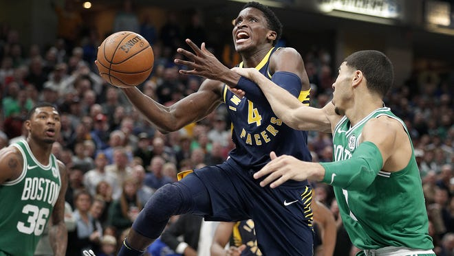 Indiana Pacers guard Victor Oladipo (4) is fouled as he shoots around Boston Celtics forward Jayson Tatum (0) in the second half of their game at Bankers Life Fieldhouse Tuesday, December 18, 2017. The Boston Celtics defeated the Indiana Pacers 112-111.