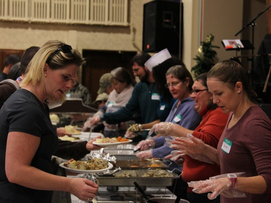 Volunteers serve Thanksgiving meals at Central Presbyterian