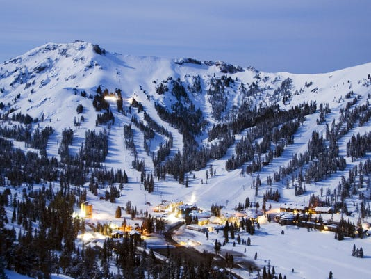 Kirkwood Mountain Resort is illuminated by the light from a full moon in the winter, California.
