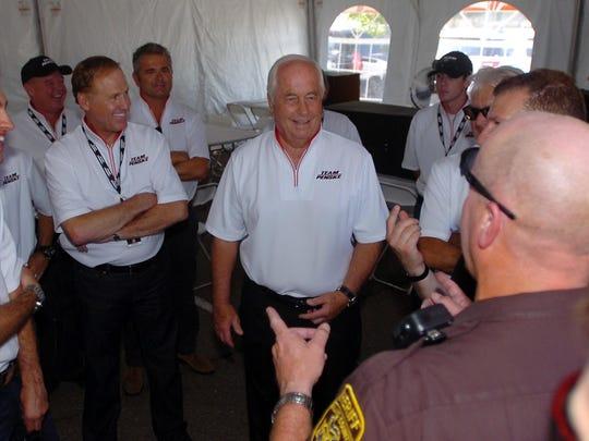 Drivers gather for details regarding their Team Penske parade down Woodward.