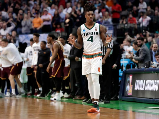 Miami guard Lonnie Walker IV (4) looks to the bench after losing the ball out of bounds in the final seconds of the second half of a first-round game against Loyola-Chicago at the NCAA college basketball tournament in Dallas, Thursday, March 15, 2018. (AP Photo/Tony Gutierrez)
