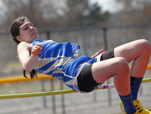 Webster Schroeder's Sarah Killip leaps her way to first place in the high jump at Saturday's Webster Invitational track meet at Webster Thomas High School.