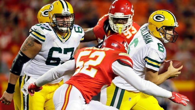 Joe Callahan of the Green Bay Packers scrambles as Dadi Nicolas of the Kansas City Chiefs chases the QB.