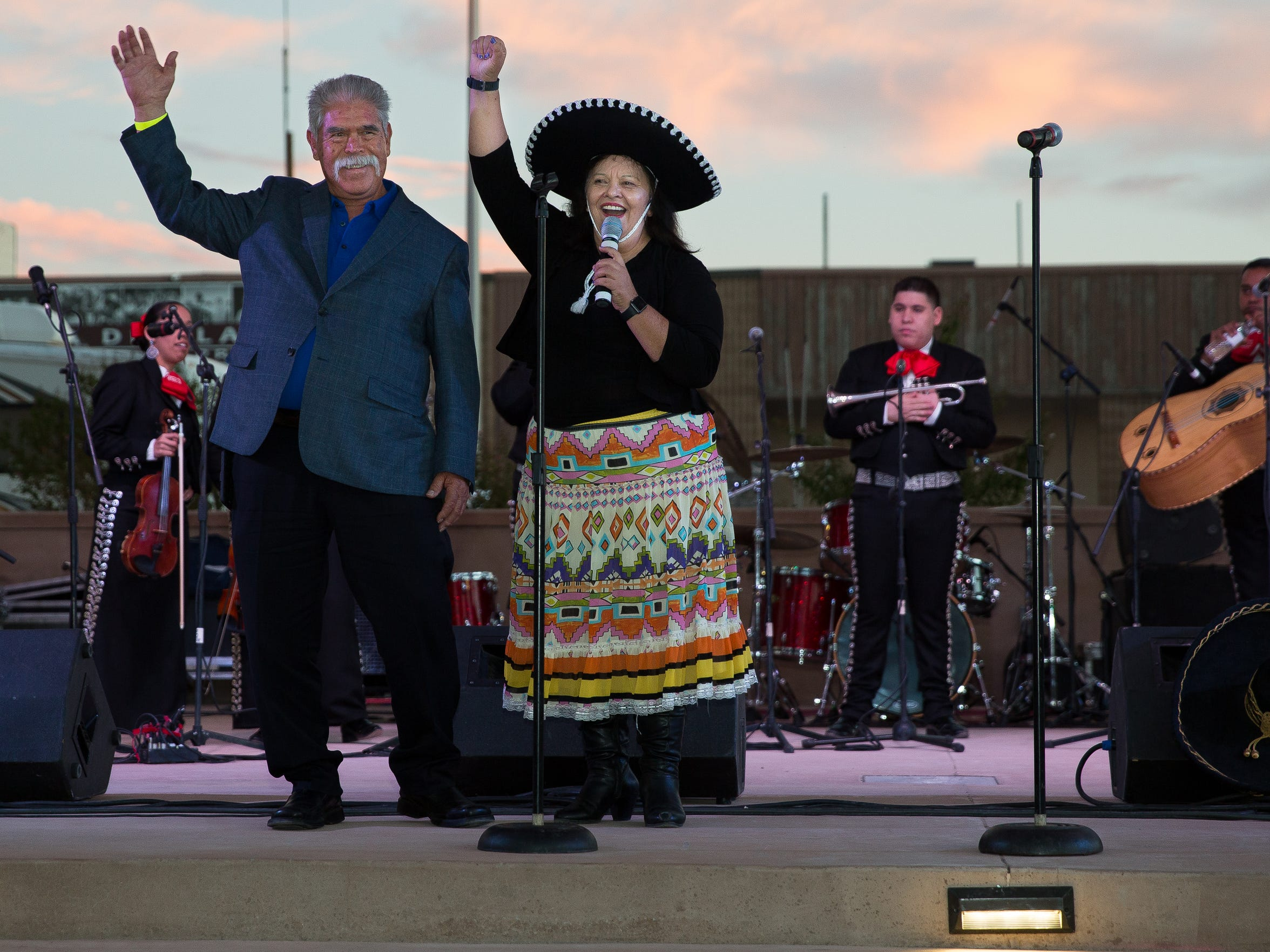 Roberto Estrada, left, and Executive Director of Cancer Aid Resource and Education (CARE) of Southern New Mexico Yoli Rigales Diaz cheer to the crowd, September 23, 2016, after announcing the Roberto's Enchilada Tasting Contest to be held on Sunday, September 25, 2016, at noon in part of The Big Event festivities.