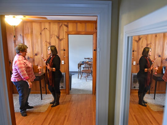 Jenny Bruce, left,  sold her home almost immediately after it was staged by Realtor Sharon Kipp, right. Kipp helped Bruce reposition her furniture to best showcase the home's features.