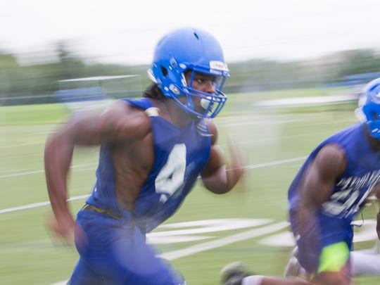Middletown running back Kedrick Whitehead runs during the first practice of the season Tuesday.