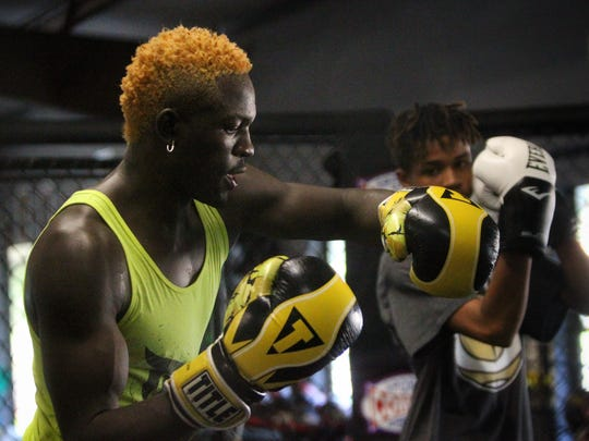 Tallahassee's Socrates Pierre teaches an MMA class