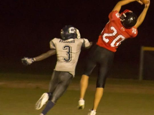 Riverdale Academy's Ryan Tomerlin hauls in a pass in