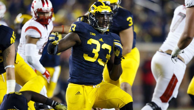 "Taco Charlton celebrates a sack of Rutgers QB Hayden Rettig. ""He's having the best camp out of all of us,"" Chris Wormley said of Charlton."