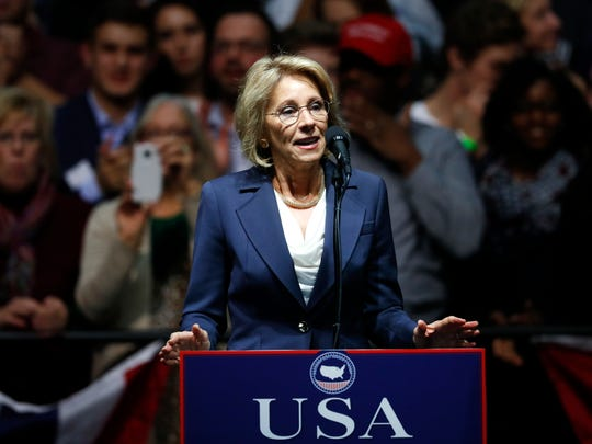 Betsy DeVos, the president-elect's pick for education secretary, speaks at a post-election rally in Grand Rapids, Michigan.