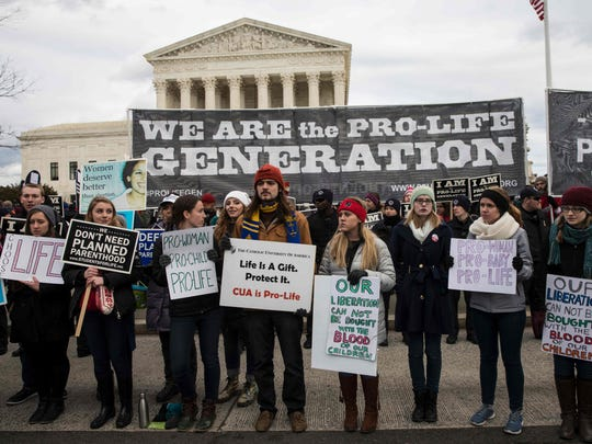 Pro-life demonstrators protest in front of the US Supreme Court during the 44th annual March for Life in Washington, DC, on January 27, 2017. Anti-abortion advocates descended on the US capital on Friday for an annual march expected to draw the largest crowd in years, with the White House spotlighting the cause and throwing its weight behind the campaign.