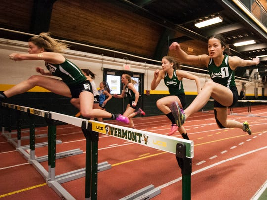 Girls compete in the 55m hurdles during the high school indoor track and field championships at Gutterson Field House on Saturday February 10, 2018 in Burlington.