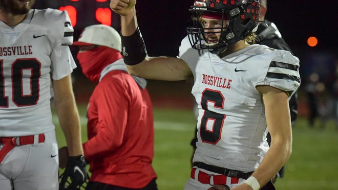 Rossville quarterback Torrey Horak gives a thumbs up to the Bulldawg crowd after leading Rossville to a 31-19 win over Nemaha Central in Friday's Class 2A state semifinal. Horak threw for 215 yards and three touchdowns and ran for 121 yards.
