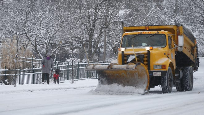 A snow plow attempts to clear Middleton Avenue in Clifton following a snow storm Jan. 21, 2014.