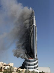 A fire burns on the Address Downtown skyscraper in