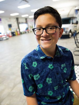 Othello Gamboa, 14, pictured at his father's car dealership. Gamboa was diagnosed with a rare illness, CCM, prevalent among Hispanic families in New Mexico.