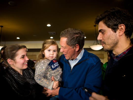 Gov. John Kasich takes a photo with Meghan, Logan Elise and Miguel Peschiera, after his town hall at Deerfield Restaurant in Manchester, N.H. Monday, Feb. 8, 2016.