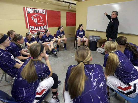 Hortonville coach Jeff Chew talks to his players before taking to the court during their girls' basketball game on Jan. 26 in Hortonville.