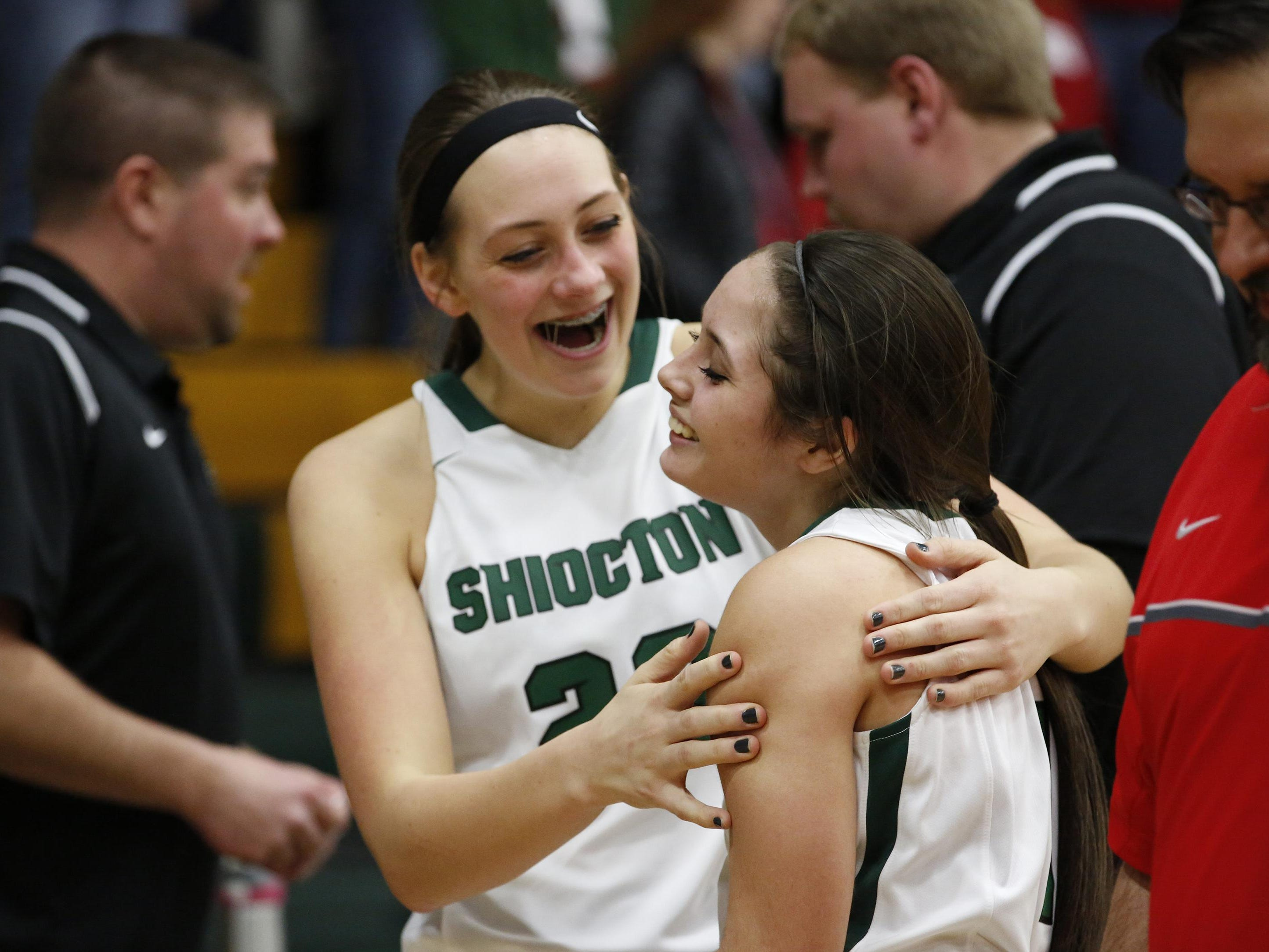 Shiocton's Jordan Elliott, left, and Madisyn Morack celebrate their WIAA Division 4 sectional semifinal win over Manitowoc Lutheran on Thursday in Green Bay.