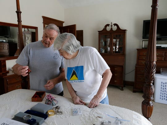 Walt and Aline Zerrenner sort and decide which jewelry items Aline will take to her room at TouchMark.