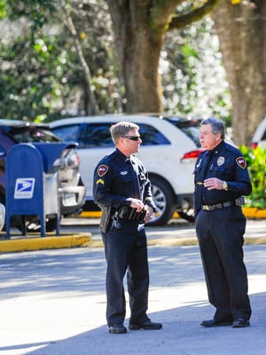 Lafayette Police Chief Jim Craft, right, speaks with an officer outside the Lafayette Police Department.
