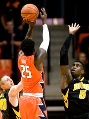 Illinois' Kendrick Nunn (25) was held to 2-for-13 shooting while mostly trying to operate against Iowa lock-down defender Anthony Clemmons, right.