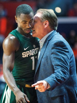 Michigan State coach Tom Izzo talks with guard Lourawls Nairn Jr. during the first half of the team's NCAA college basketball game against Illinois in Champaign, Ill., Wednesday, March 1, 2017. (AP Photo/Rick Danzl)