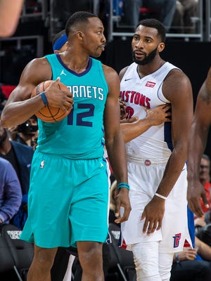 Pistons' Andre Drummond and Hornets' Dwight Howard exchange words after a play in the opener at Little Caesars Arena on Oct. 18, 2017 in Detroit.