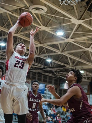 Northside's Billy Sonnier (23) goes for the rebound and the bucket as the Northside boys basketball team plays Breaux Bridge Friday Jan. 5, 2017.