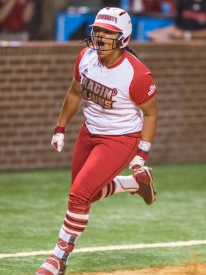 UL outfielder Beth Ashley (29) turns third base after hitting a three-run home run as the Ragin' Cajuns softball team plays host to the South Alabama Jaquars in game two of a doubleheader Friday March 30, 2018.