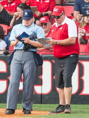 UL softball coach Gerry Glasco, right, makes a lineup change during the Ragin' Cajuns' series sweep of South Alabama last weekend.