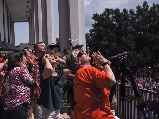 Clemson University librarians wear solar glasses to see the solar eclipse over Clemson University on Monday, August 21.