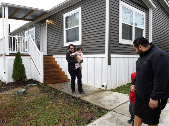 Cesar Melchor and wife Maria Gomez take a walk around their Shady Hills Mobile Home Park neighborhood with two of their children Jacob and Natalia.