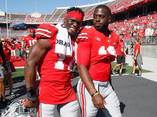 Ohio State linebacker Jerome Baker is all smiles as he leaves the field after the rout of UNLV with quarterback J.T. Barrett.
