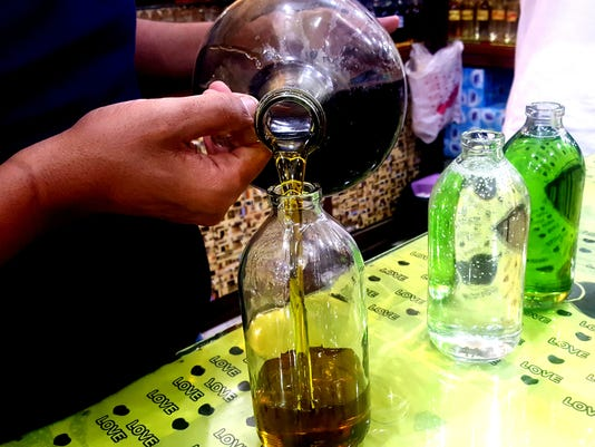 636649145478943195-Essence-of-Life-Al-Fayed-Pouring-Sandalwood-Oil-and-Eucalyptus.jpg