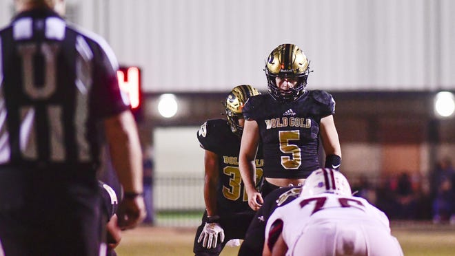 Post quarterback Slayden Pittman (5) stands in the pocket during a Sept. 11 game against Littlefield at Jimmie Redman Memorial Stadium in Post.