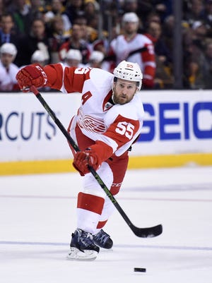 Red Wings defenseman Niklas Kronwall (55) passes the puck during the first period of Thursday's loss in Boston.