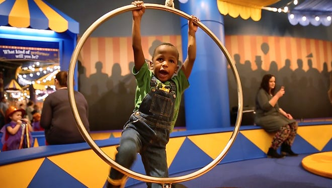 "Ian Huskins enjoys the Lyra or aerial rings, at the new ""Circus--Starring YOU!"" exhibit at the Children's Museum of Indianapolis, Friday, February 17, 2017."