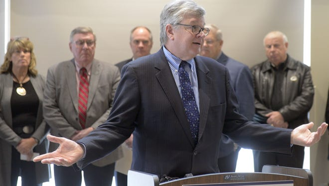 """Appleton Mayor Tim Hanna talks at a press conference Monday, Dec. 11, 2017, at Ashwaubenon Community Center to demand that state lawmakers close the so-called """"dark stores"""" loophole.  Northeast Wisconsin local-government representatives say the loophole shifts property tax burden from big-box retailers to homeowners and small businesses."""
