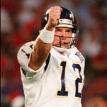 San Diego Chargers quarterback Stan Humphries reacts after the Chargers scored a touchdown against the San Francisco 49ers in the first quarter of Super Bowl XXIX in 1995 at Joe Robbie Stadium in Miami.