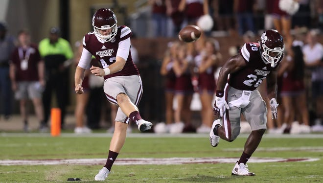 Logan Cooke punts in a game last season for Mississippi State.