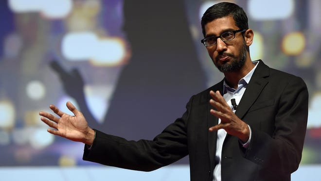 Caption:Google's Senior Vice President Sundar Pichai gives a keynote address during the opening day of the 2015 Mobile World Congress (MWC) in Barcelona on March 2, 2015.