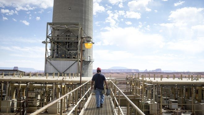 Alex Tsinnjinnie of the operations department walks on the 200-foot level at Navajo Generating Station near Page.