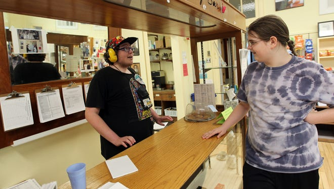 """James """"Jonny"""" Sullivan, left, chats with Dimitri Cox at Jonny's Milk Bar inside Wild Bill's at North Hall on Tuesday, April 25, 2017. The Zelda-themed milk bar offers a variety of flavored milk."""