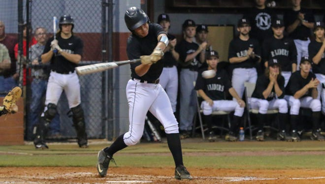 Navarre's Andre Macedo swings against a pitch. The Navarre Raiders travel Thursday to face West Florida High.