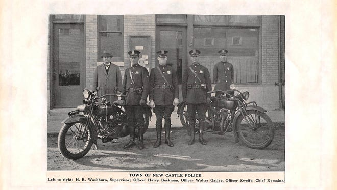 Officer Joseph Zwiefel, second from right, is shown in this undated historical photo.