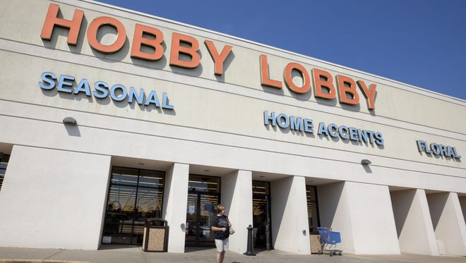 FILE  A woman walks from a Hobby Lobby Inc., store in Little Rock, Ark., Wednesday, Sept. 12, 2012. The Oklahoma City-based chain filed a federal lawsuit over a mandate in the health reform law that requires employers to provide coverage for the morning-after pill. (AP Photo/Danny Johnston)